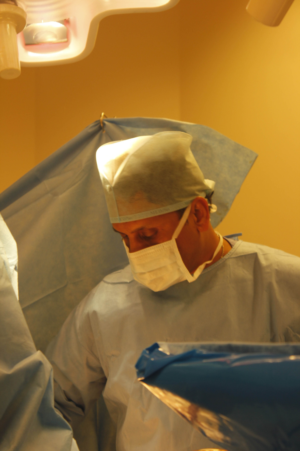 surgeon performing hair transplant