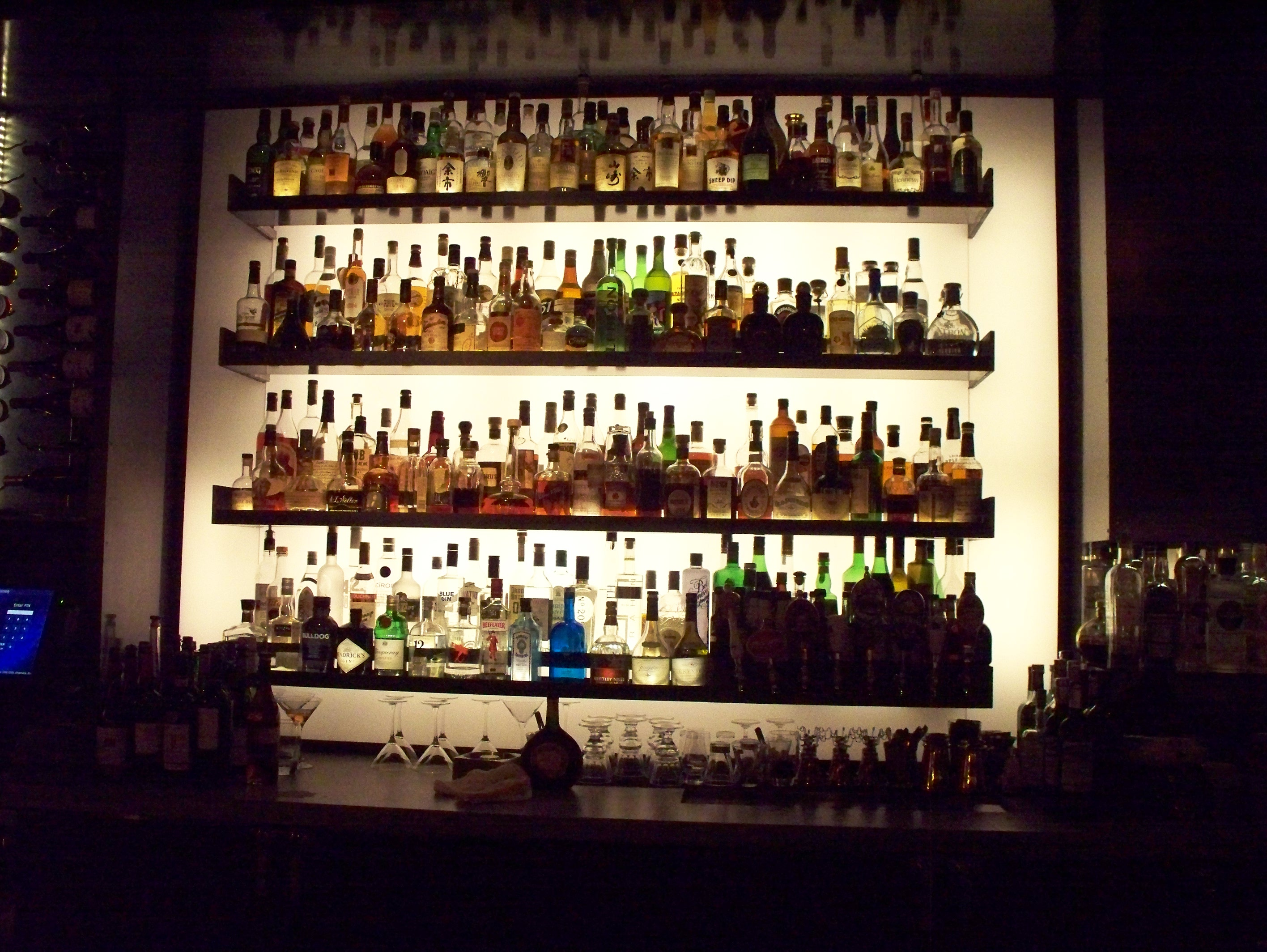 File Liquor Bottles On A Bar Wall Jpg Wikimedia Commons