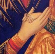 Detail of the hands of the virgin.