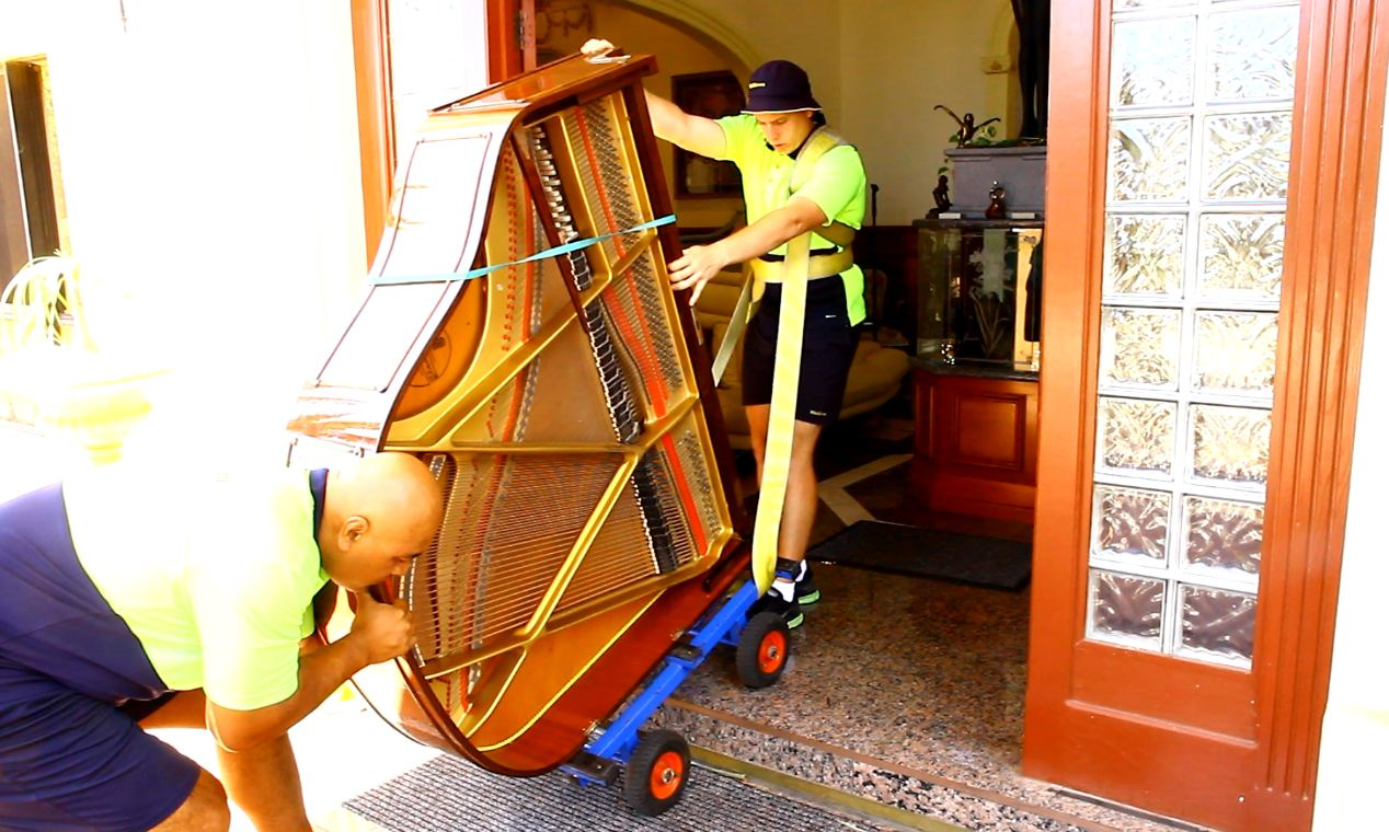 Cheap Moves expert Gold Coast removalists moving a piano safely