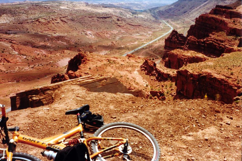 mountain bike laying down next to a canyon