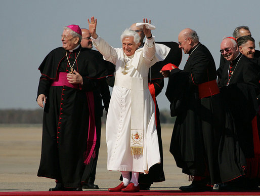 Pope Benedict XVI acknowledges the cheers of the crowd