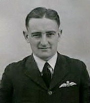 Head-and-shoulders portrait of man in dark uniform with pilot's wings