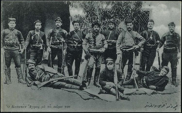 """""""Kapetan Agras with his band"""" (standing middle)."""