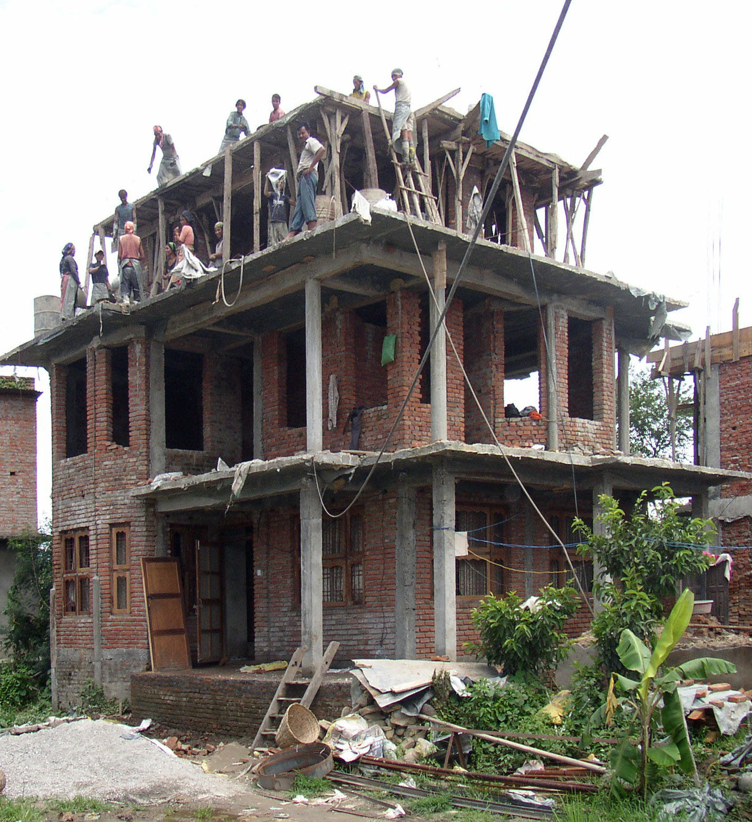 File building a house nearby the street between kathmandu and nagarkot