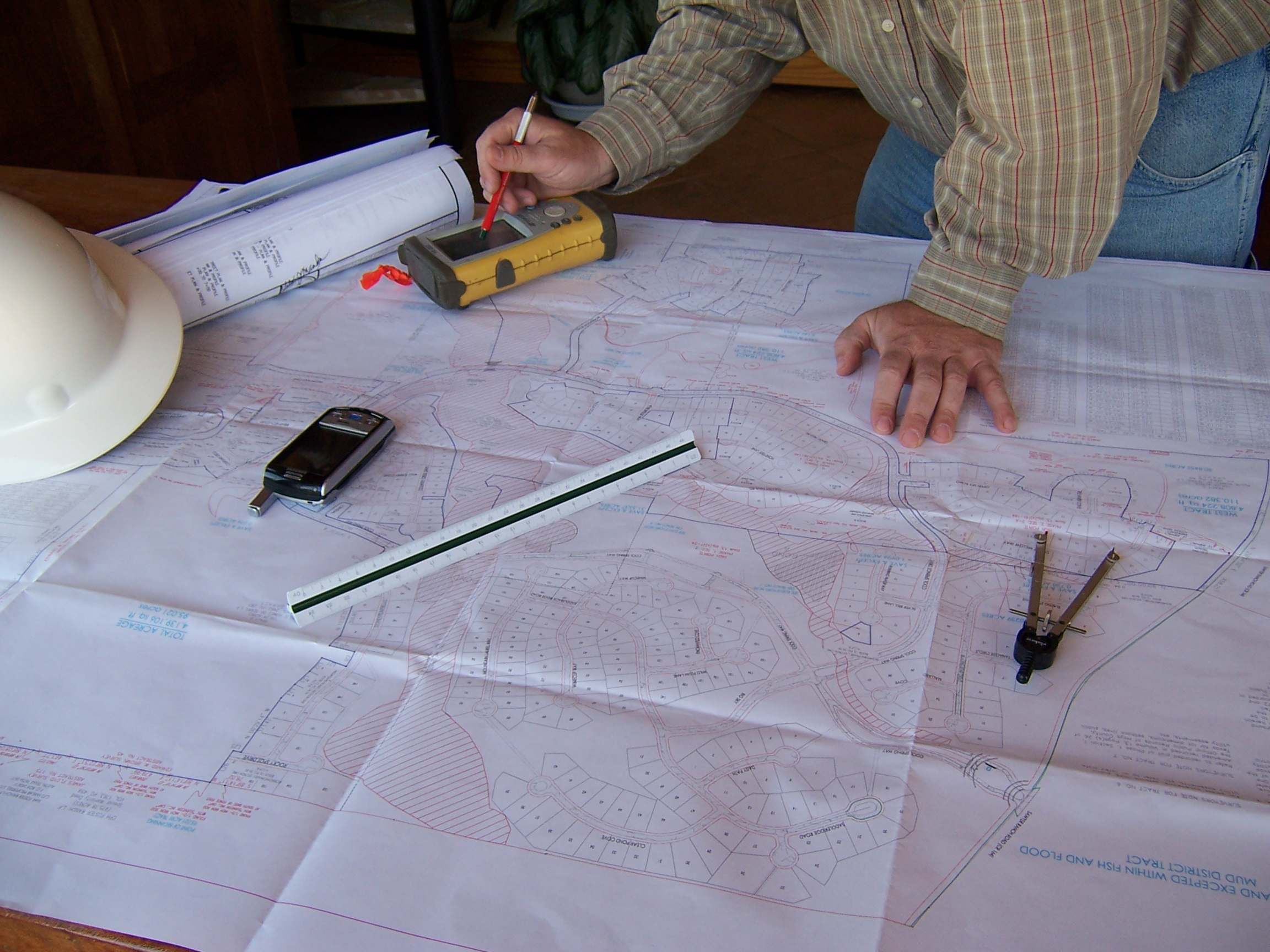 Engineer with blueprints and tools