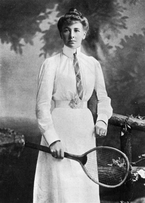 woman dressed in white holding an Olympic tennis racquet