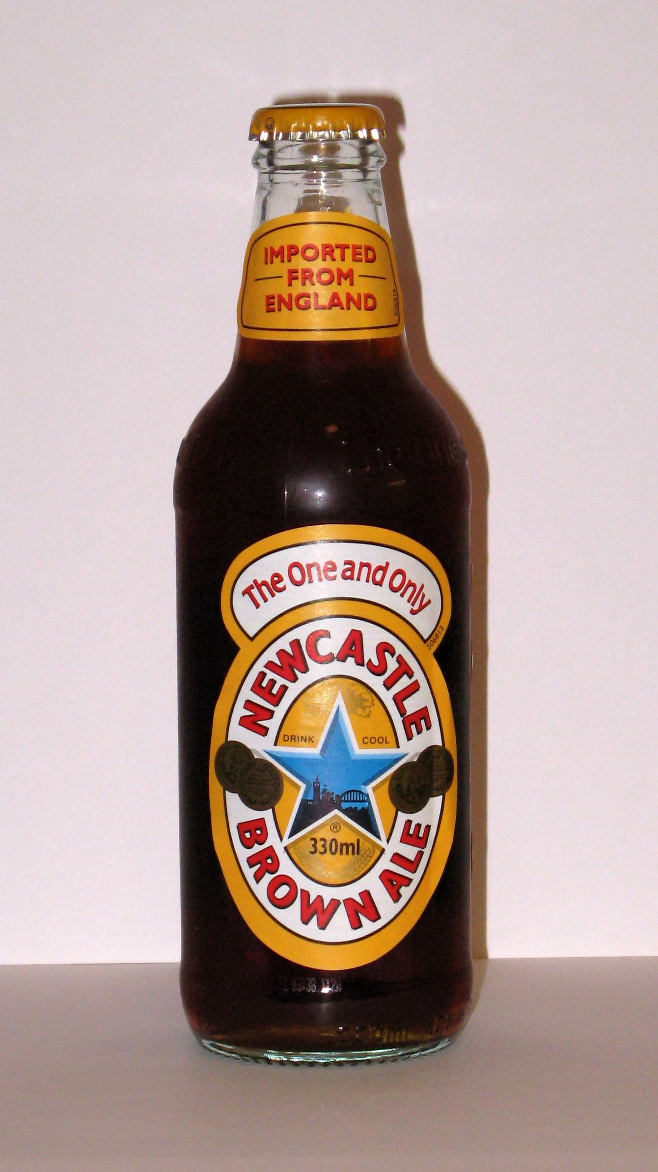 A full bottle of Newcastle Brown Ale