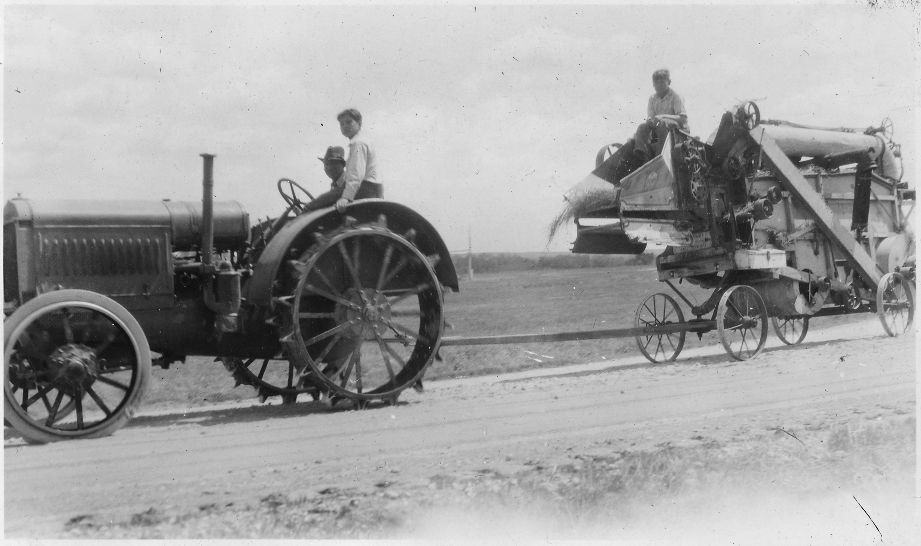 Black White An D Tractor Pulling Wagon : File tractor pulling combine along the road nara