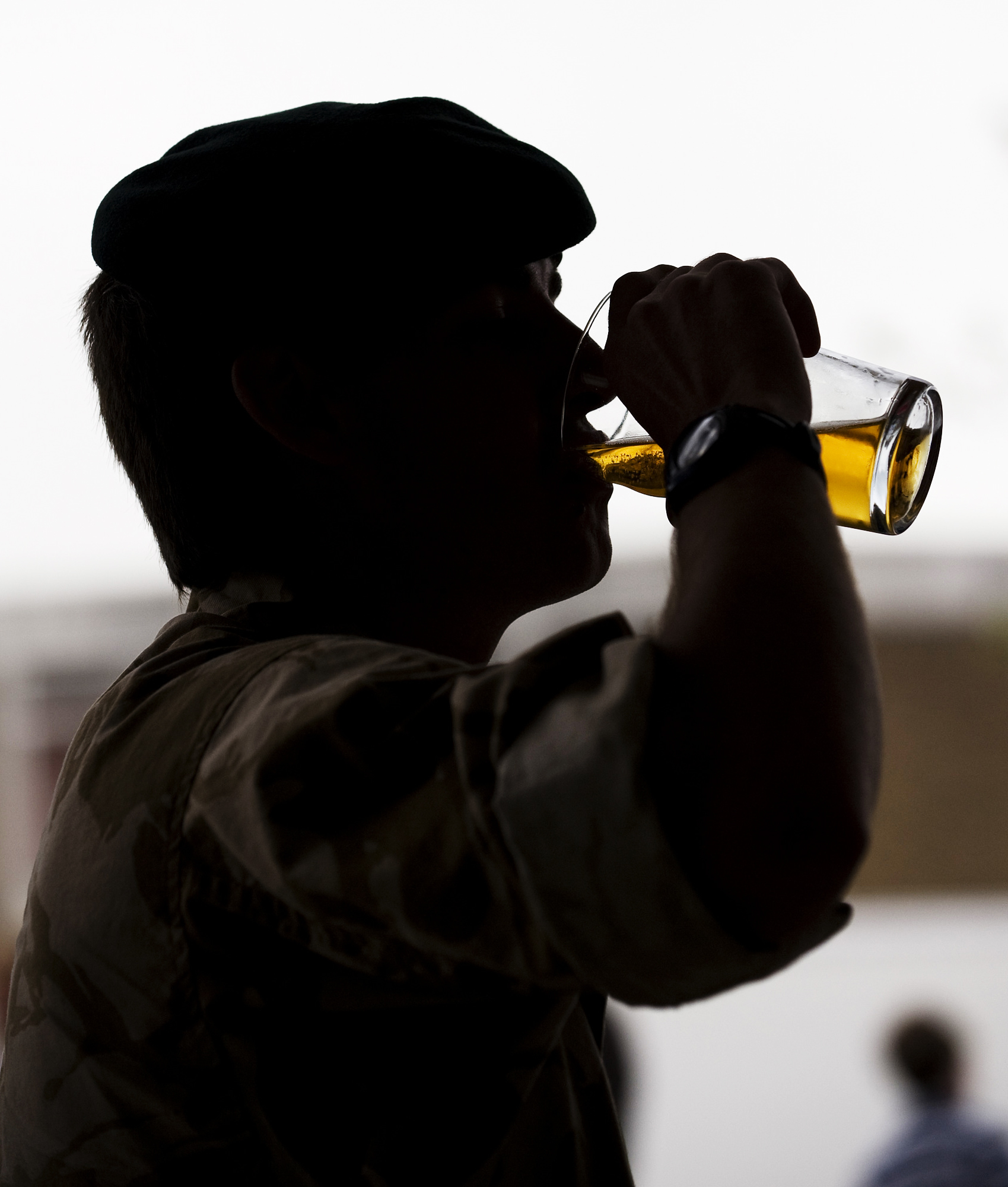 A Soldier Drinks a Pint of Beer on his Return from Afghanistan MOD 45152497.jpg