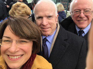File:Amy Klobuchar selfie with Senators McCain and Sanders during 2017 inauguration C2oYpO6XcAArD5E.jpg
