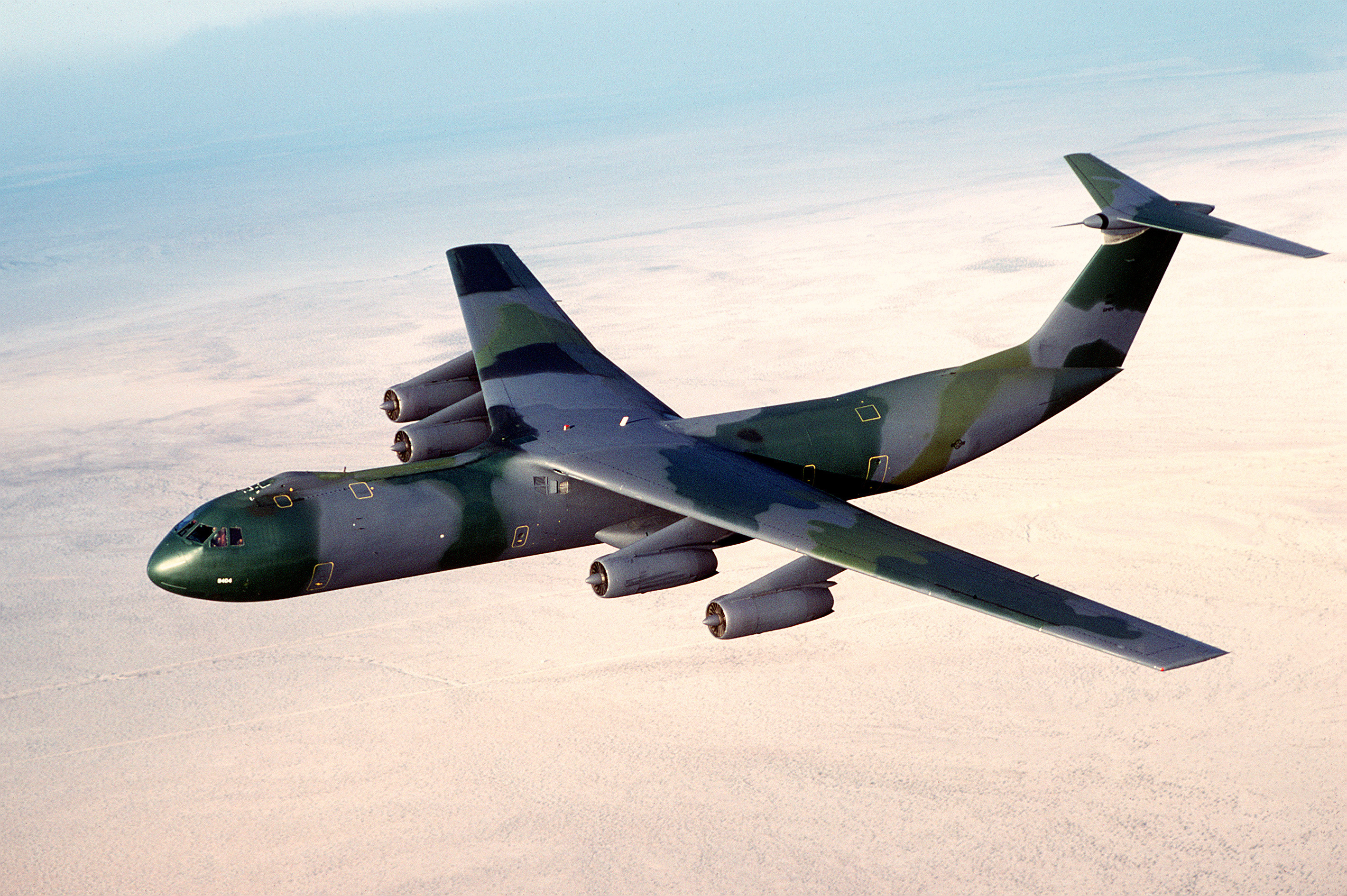 An_air-to-air_left_side_view_of_a_C-141B