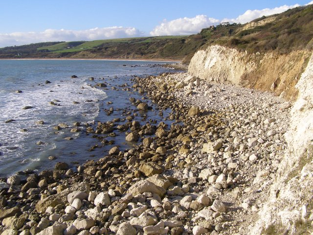 Rocky beach exposed at low tide, Ringstead Bay - geograph.org.uk - 266850