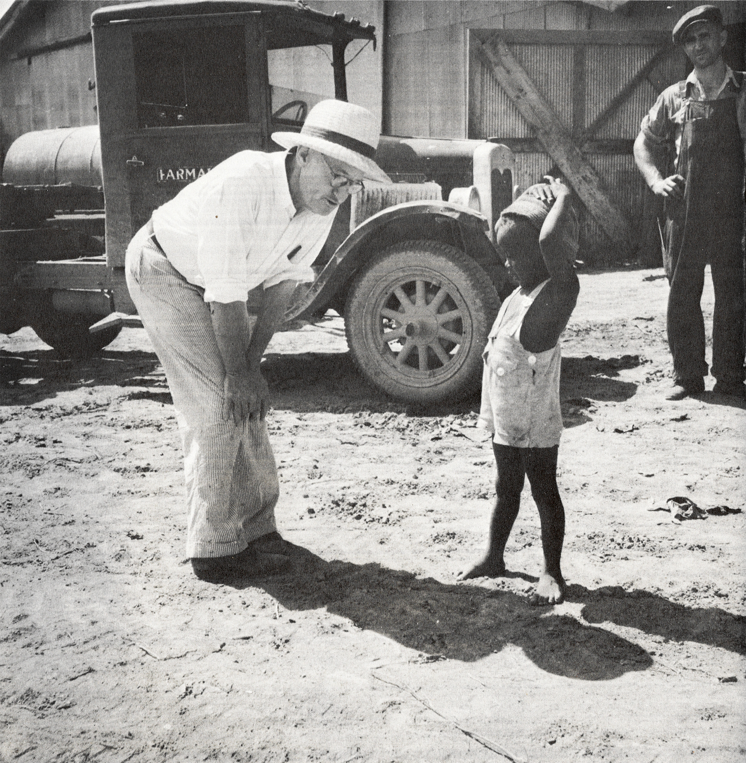 The owner of the Aldridge Plantation with one of the plantation children Leland (vicinity) June 1937.
