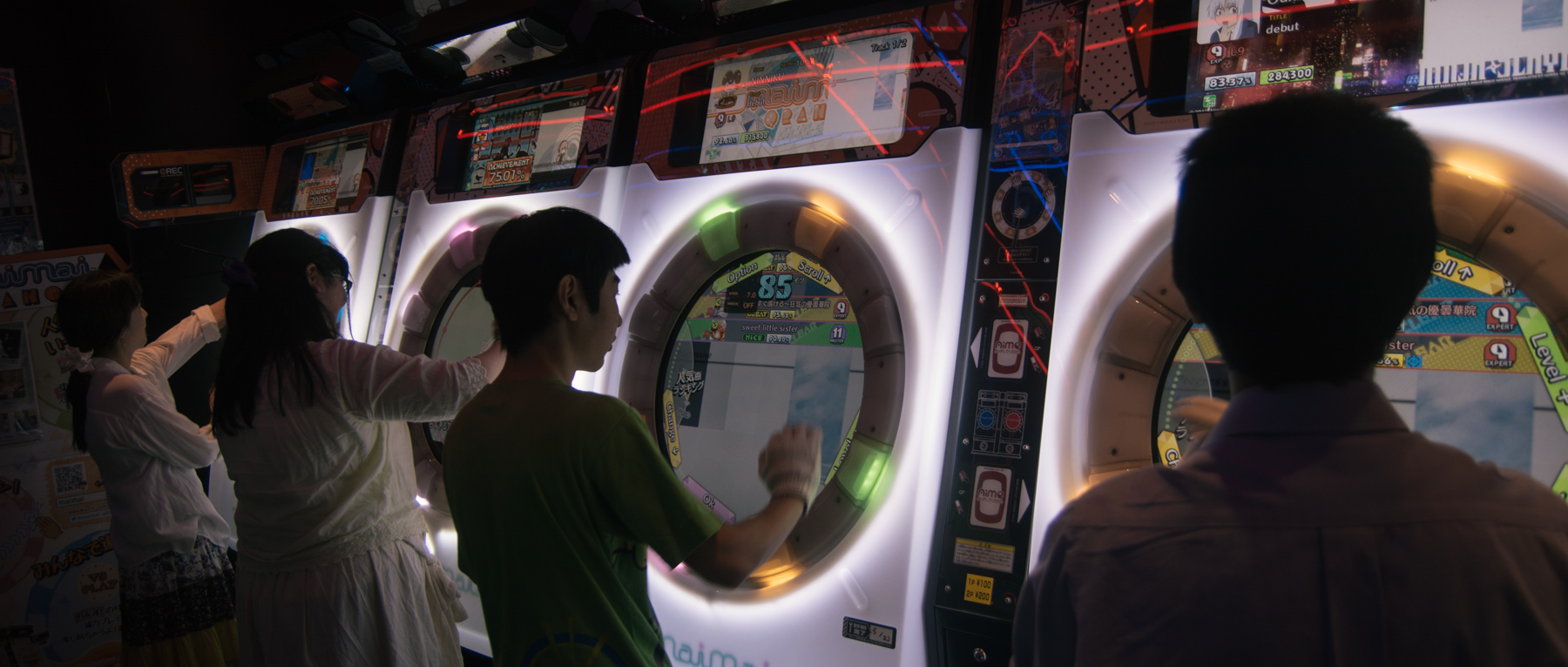 People playing video games at a 2015 event in Tokyo
