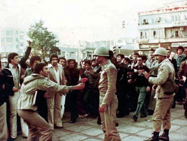 A protester giving flowers to an army officer 1979 Islamic Revolution.jpg