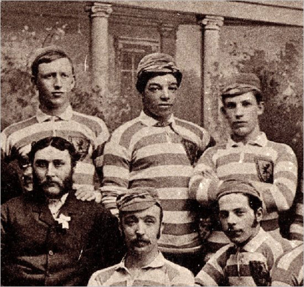 Scotland players, including Andrew Watson (top centre), wearing the Rosebery colours of primrose and pink in 1882 Andrew Watson Footballer.jpg