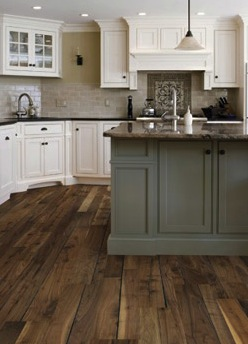 What are the practical considerations of wood flooring in a kitchen setting?