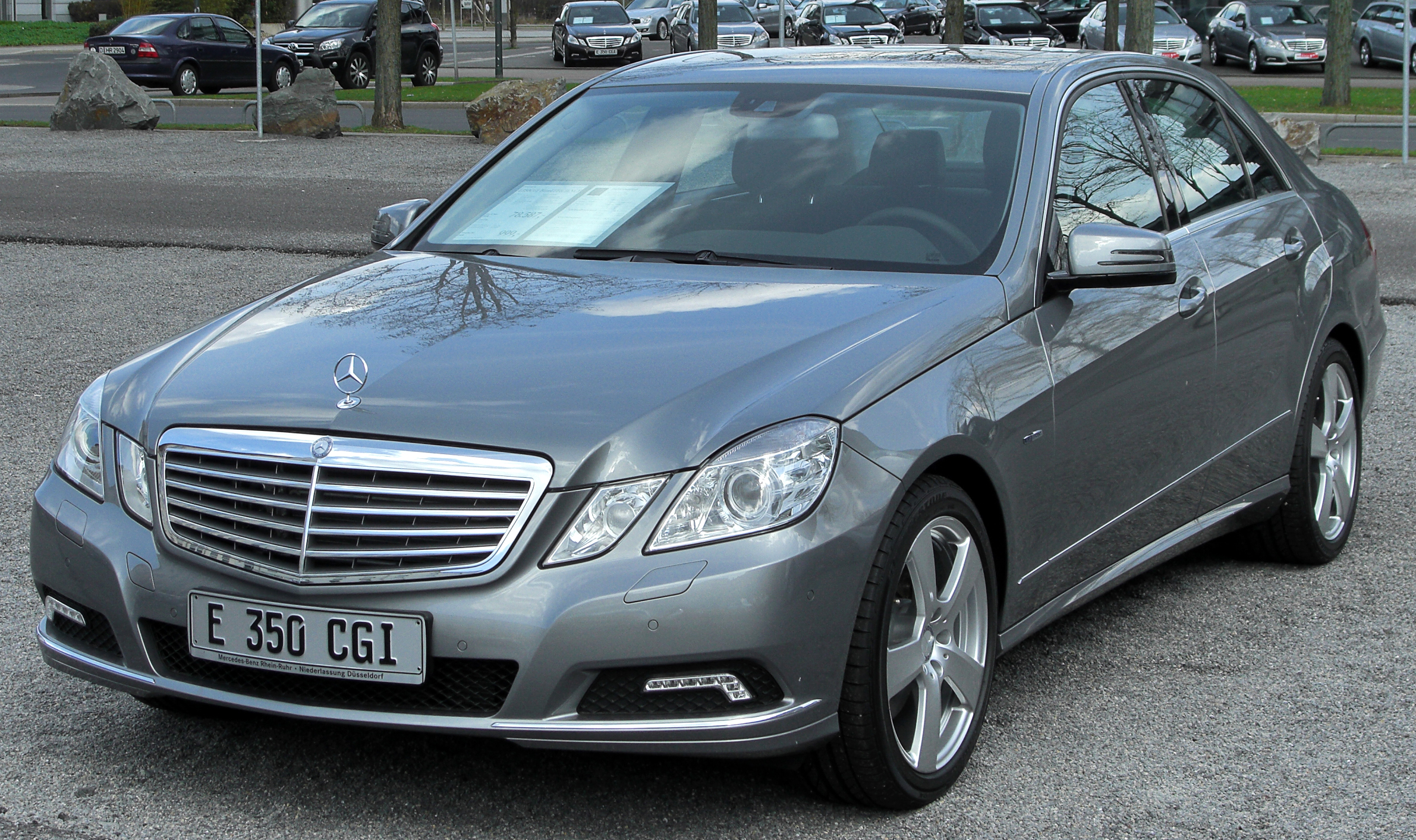 File Mercedes Benz W211 E 55 AMG Calcitwei C3 9F Heck further File Mercedes Benz Bank besides Price Quotes in addition Bahnhofmain Station Stuttgart Germany P2341 additionally Price Quotes. on mercedes benz logo usage