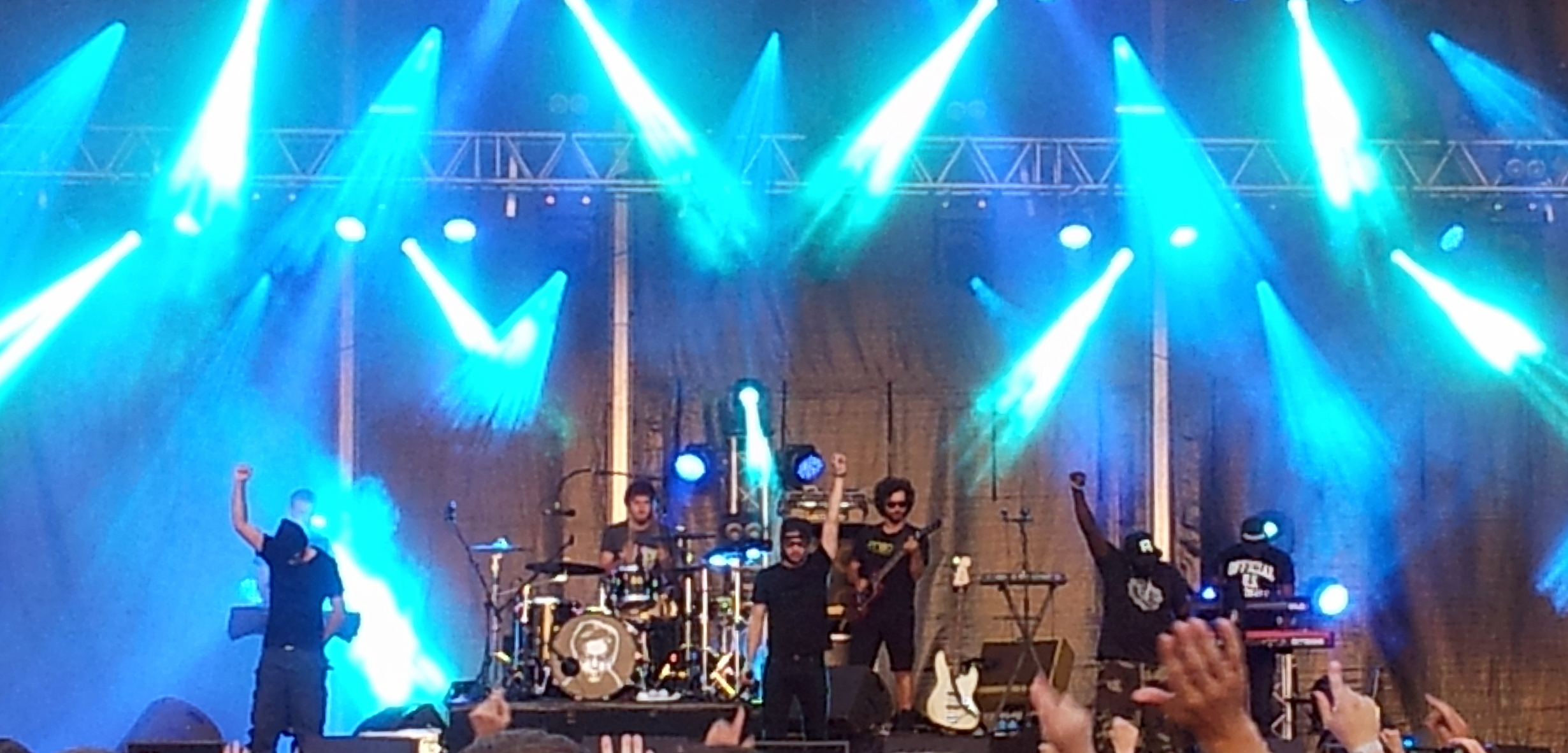 Orelsan (middle) performing at the Nuits Secrètes Festival at Aulnoye-Aymeries, France on 4 August 2013.