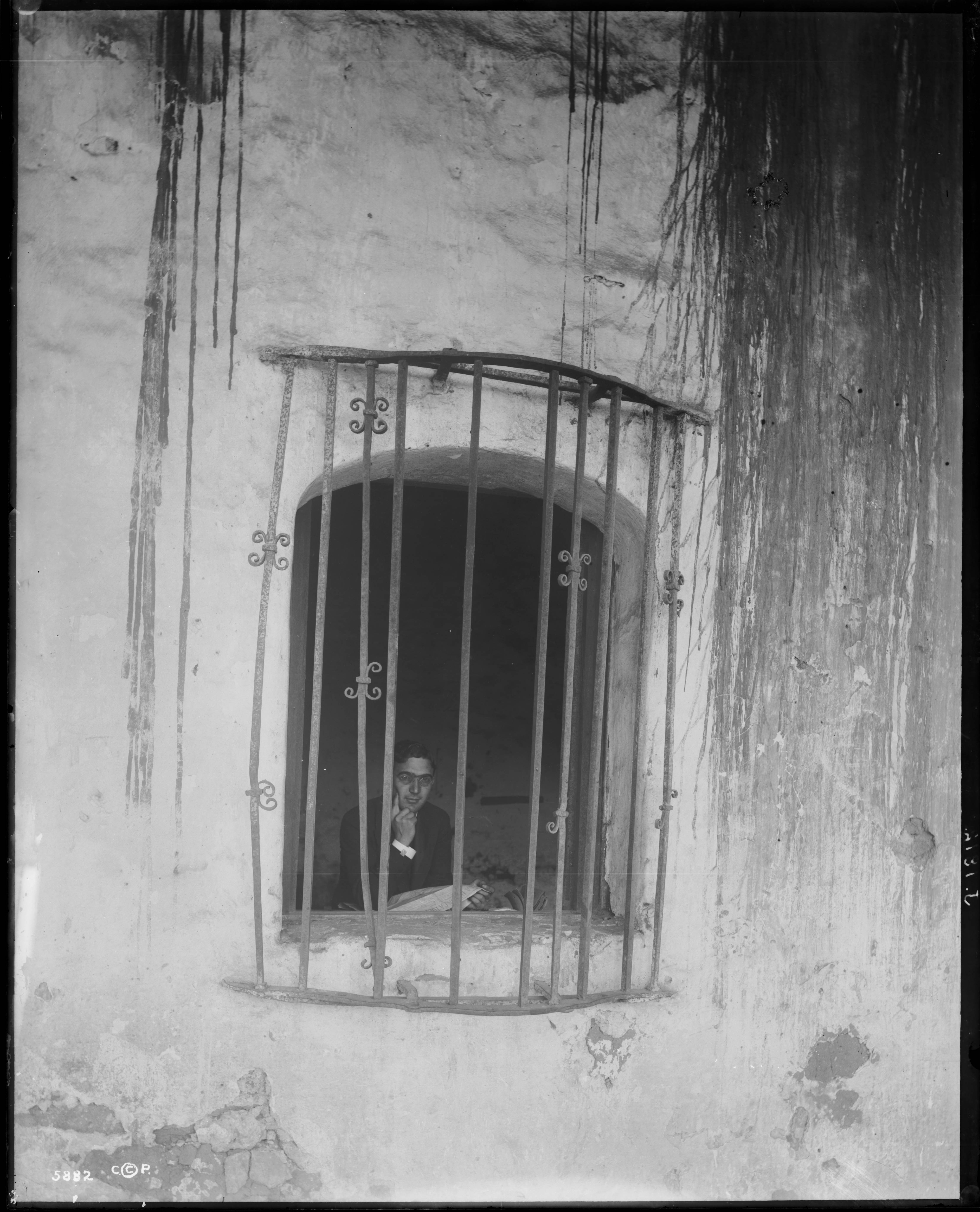 Fileportrait Of Father Aquire Liebana Looking Out From A Barred