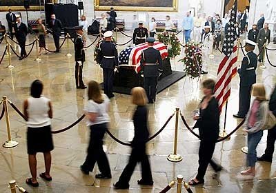 Ronald Reagan, 40th President of the United States, lying in state in the United States Capitol Rotunda as spectators and mourners file past his flag draped casket on June 10, 2004. - State funeral