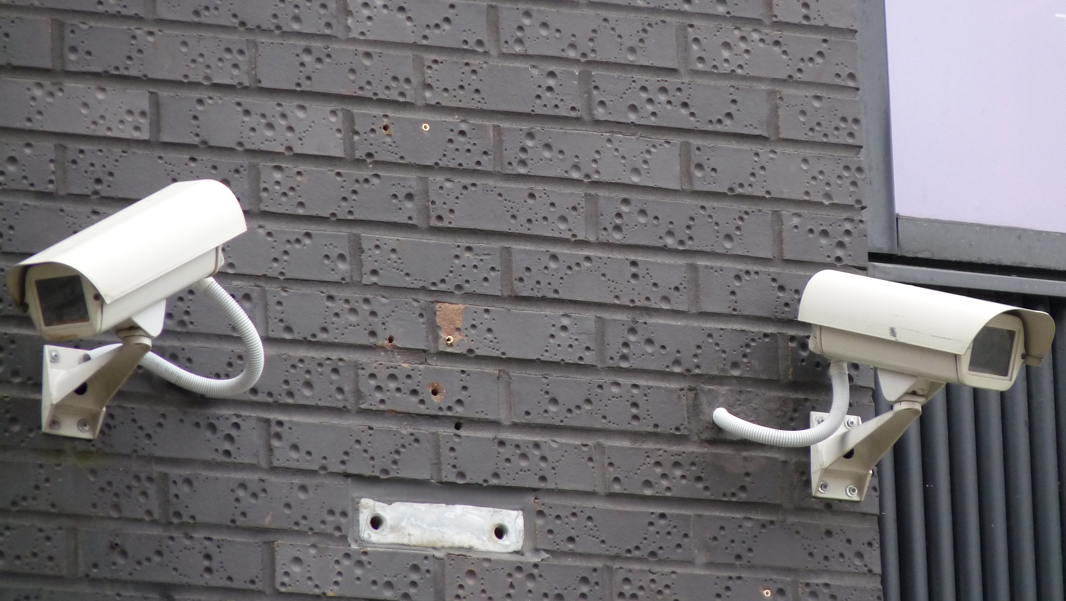 Cameras mounted on a wall.