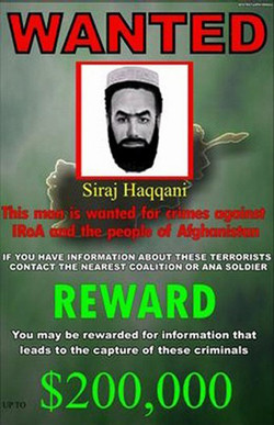 English: A wanted poster of warlard Sirajuddin...