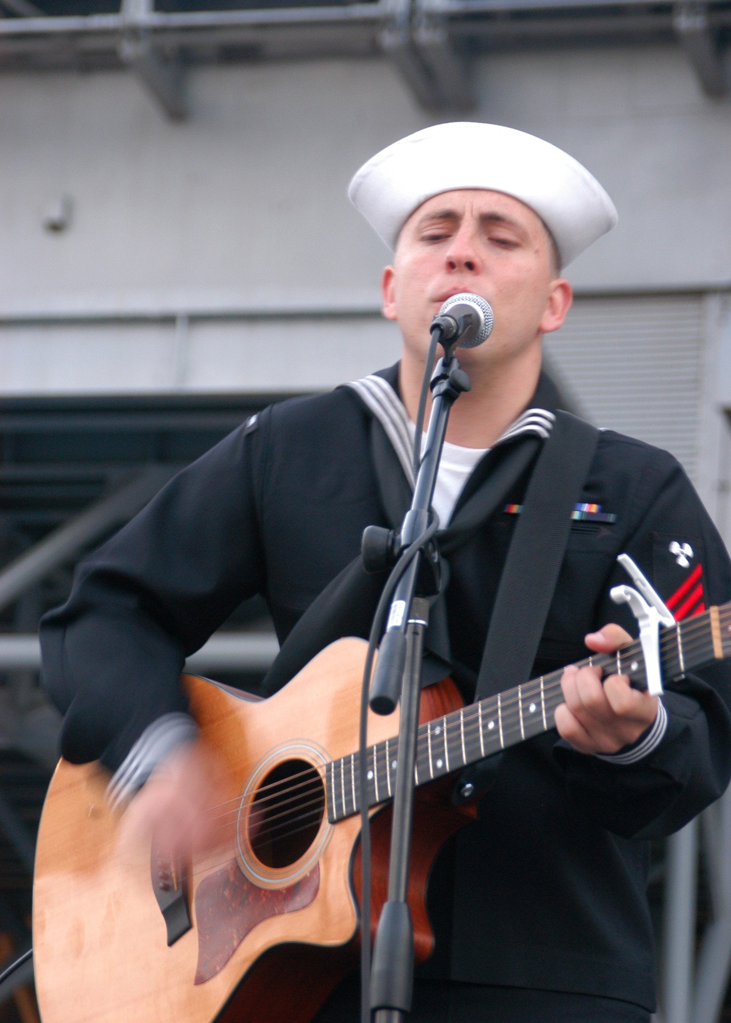 081109-N-6043G-075 Machinist's Mate Fireman Tommy Stanley performs outside the newly renovated Intrepid Sea, Air ^ Space Museum in Manhattan.jpg English: NEW YORK (Nov