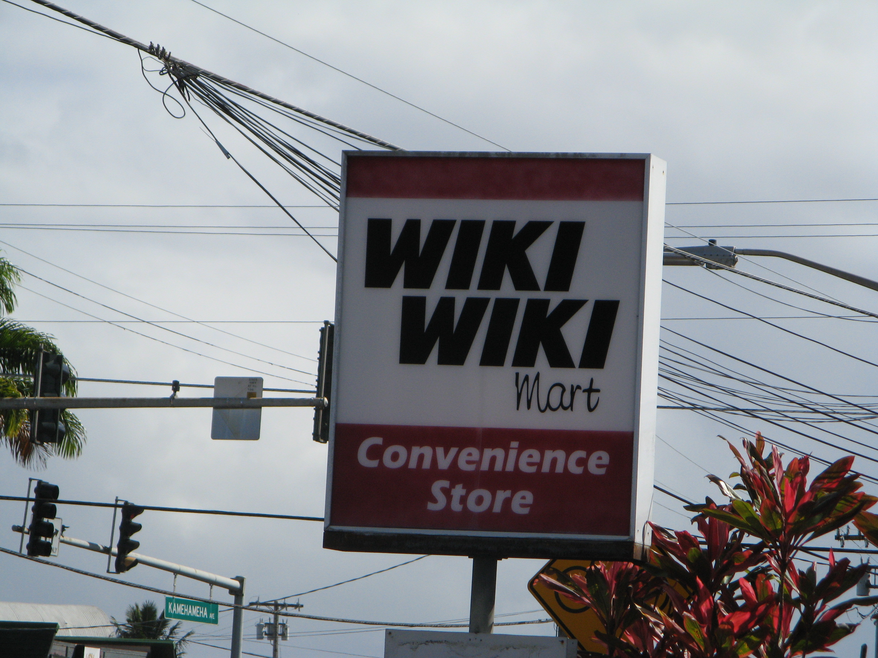 A grocery sign showing Wiki Wiki Mart
