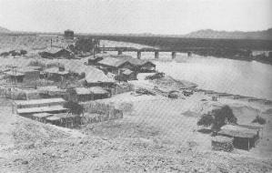 Yuma Crossing in 1886. The railway bridge over the Colorado River was built in 1877. Yuma Crossing and RR bridge in 1886.jpg