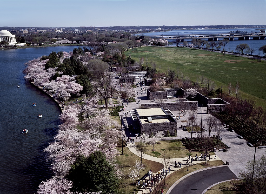 ariel picture of a four room monument, surrounded by cherry blossom trees