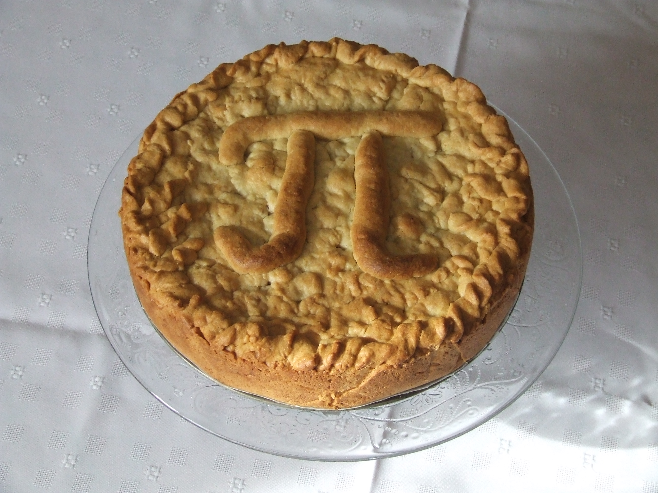 apple pie with a Pi symbol baked into the crust