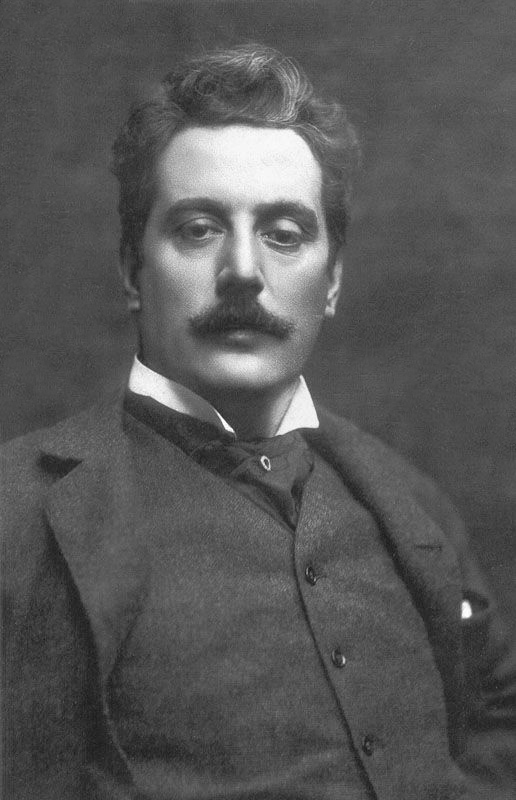 Composer Giacomo Puccini in a studio photograph.