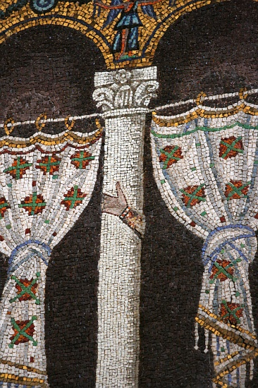 Once the Orthodox Trinitarians succeeded in defeating Arianism, they censored any signs that the perceived heresy left behind. This mosaic in Basilica of Sant'Apollinare Nuovo in Ravenna has had images of the Arian king, Theoderic, and his court removed. On some columns their hands remain. PalatiumTheodoricMosaicDetail.jpg