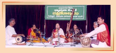 Performers of mridangam, violin, vocals, tambura, harmonium and tabla