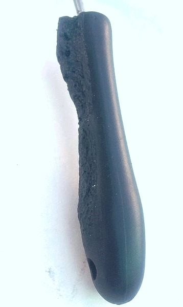 The plastic handle of a spatula that has been deformed by heat. Melted plastic.jpg