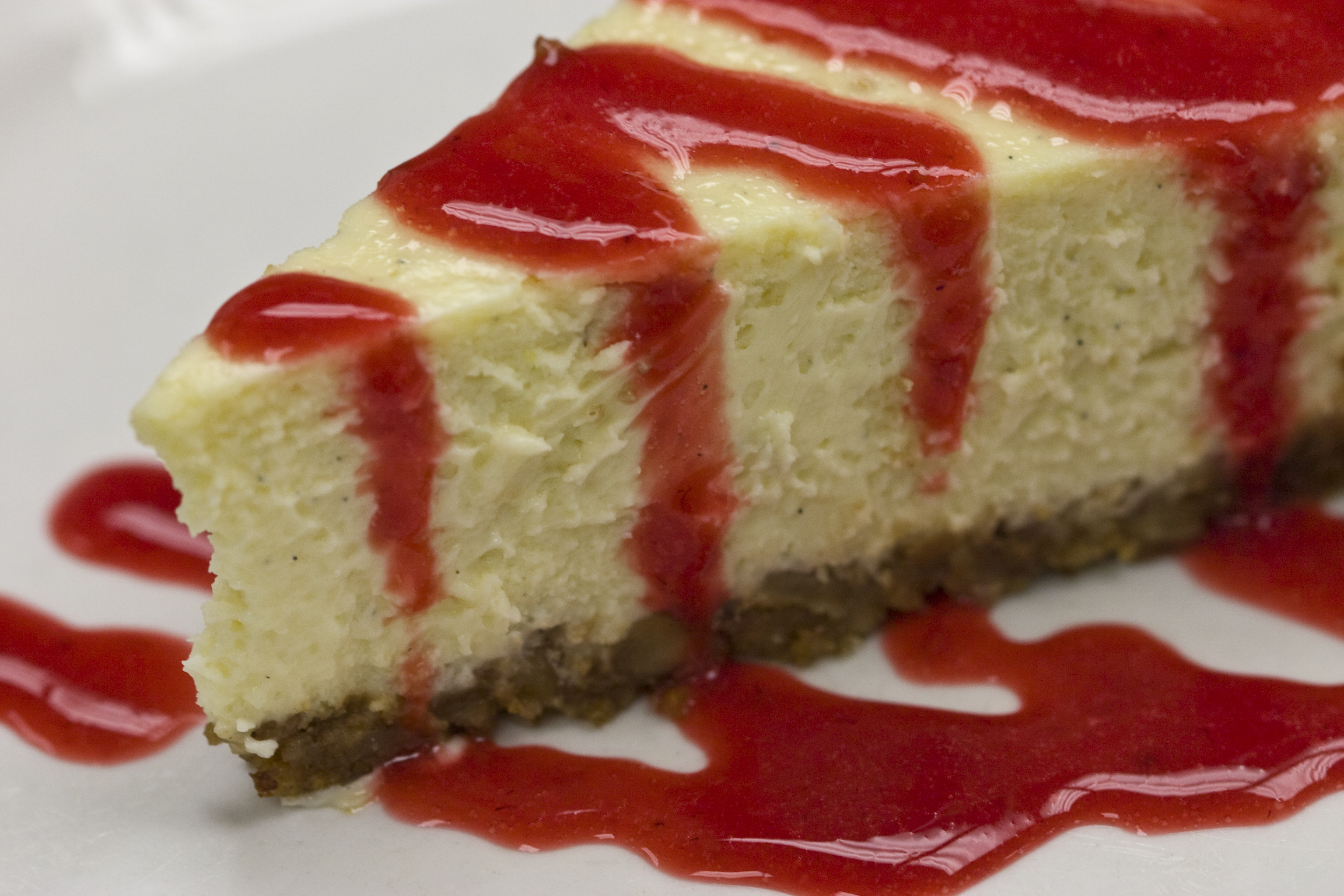 Description Mondays at Il Forno - Cheesecake with strawberry sauce.jpg