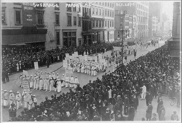 Women suffragettes fight for voting rights.