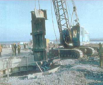 Ukrainian workers use equipment provided by the U.S. Defense Threat Reduction Agency to dismantle a Soviet-era missile silo. After the end of the Cold War, Ukraine and the other non-Russian, post-Soviet republics relinquished Soviet nuclear stockpiles to Russia. SS-24 silo destruction.jpg
