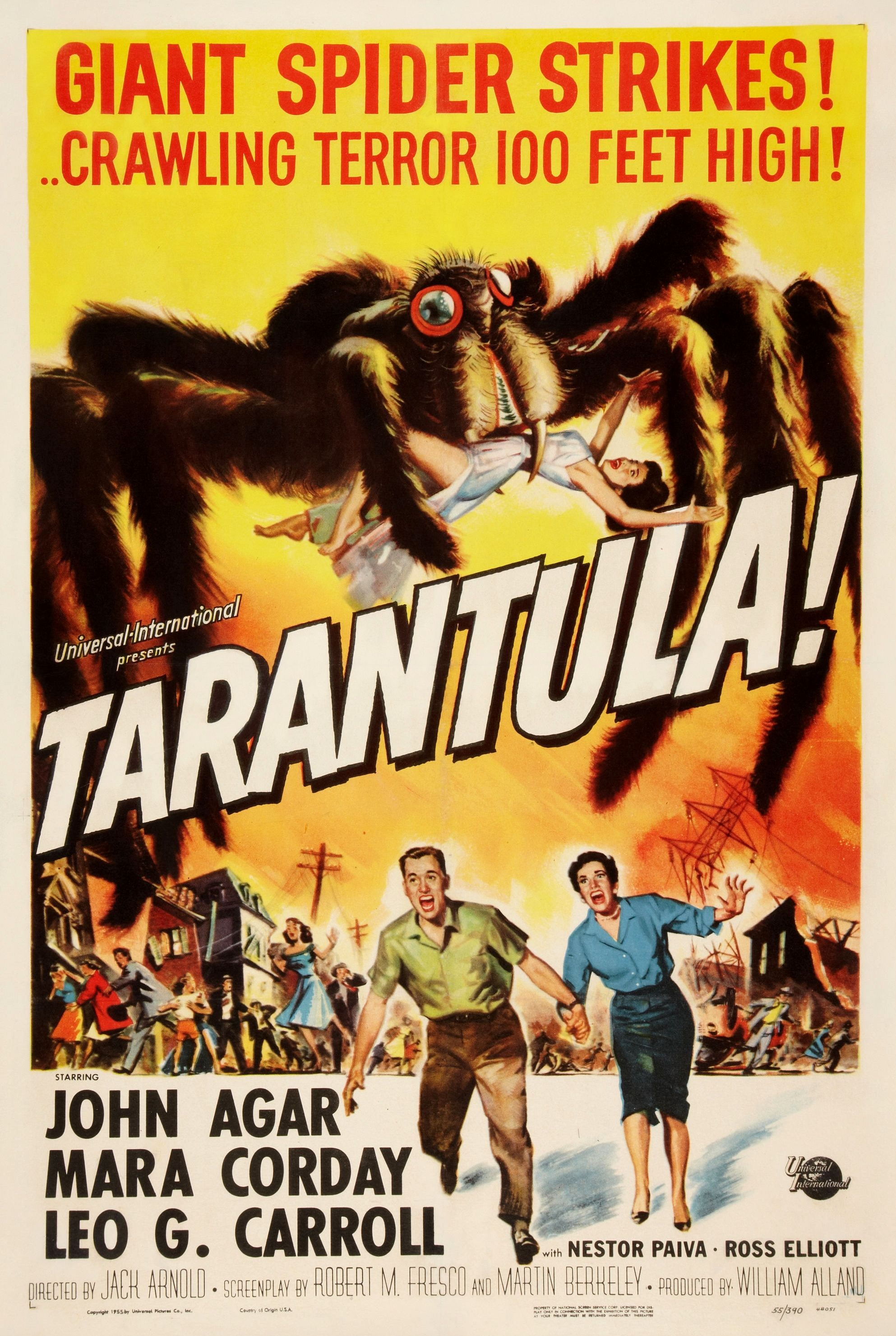 "Movie poster for the for the 1955 film ""Tarantula!"" The poster shows a giant tarantula with a woman in its pincers trampling a town as people run in terror. The tagline reads ""Giant spider strikes! Crawling terror 100 feet high!"""