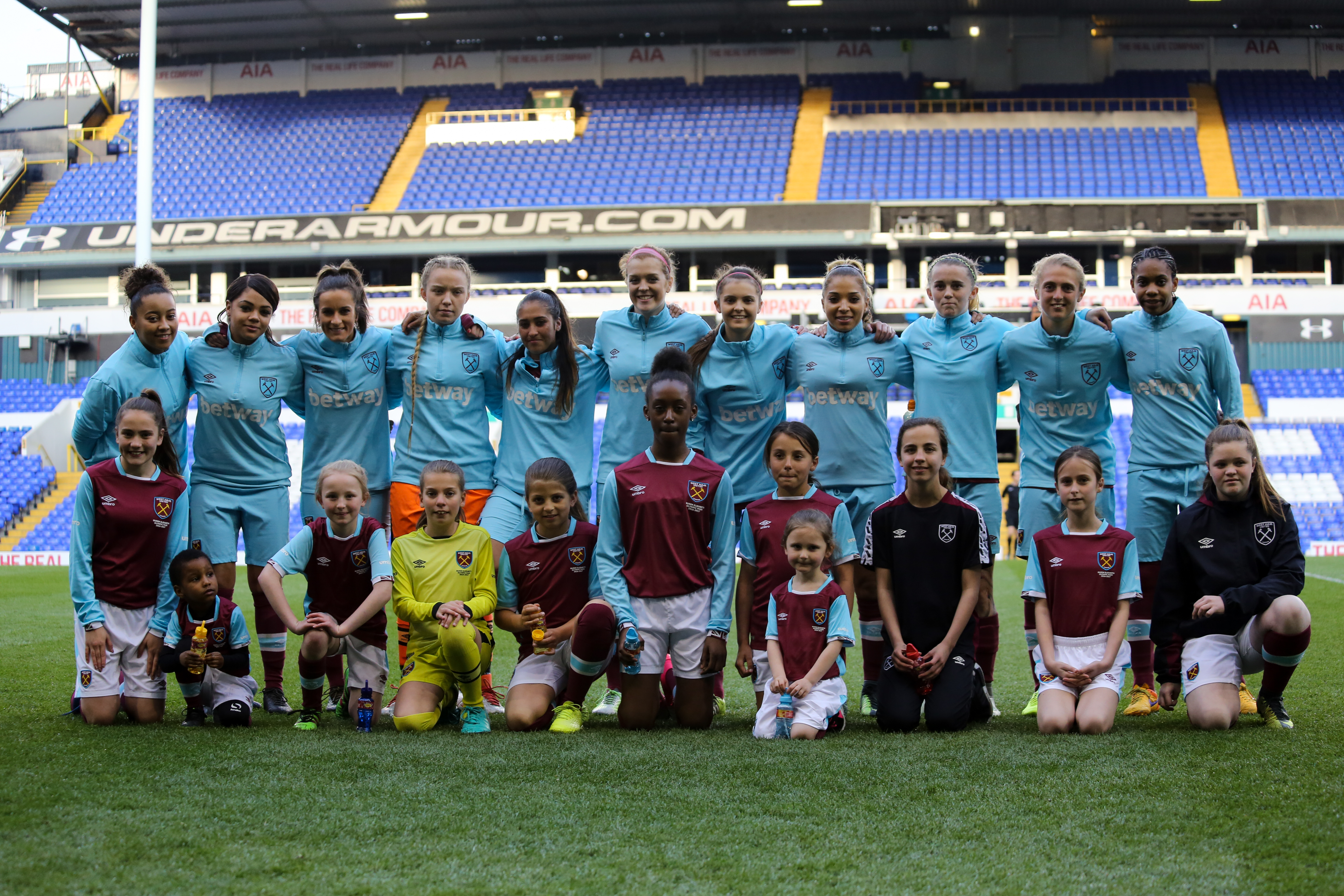 West Ham team with their player escorts in April 2017 prior to a match  against Tottenham Hotspur at White Hart Lane. e27b233f4