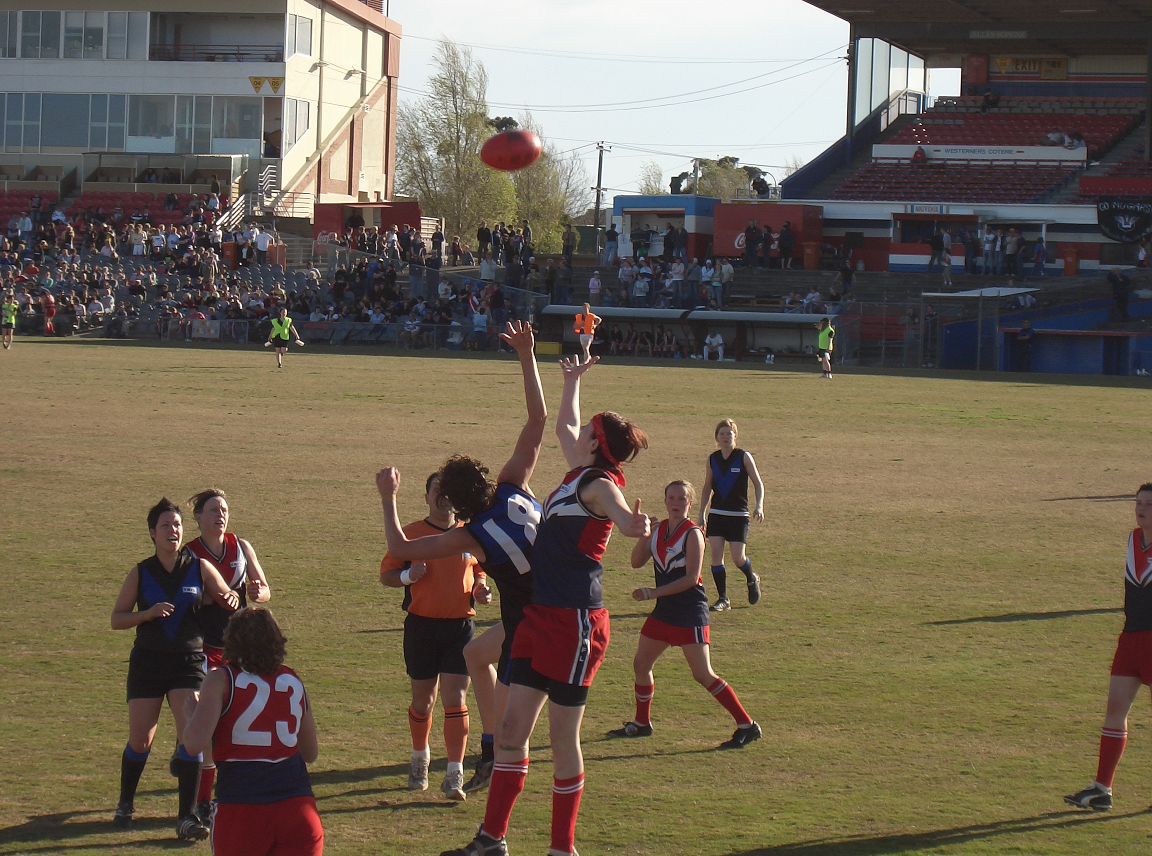 The Grand Final of the Victorian Women's Football League, Division 1. Melbourne University MUGARS (black and blue) def. Darebin Falcons.