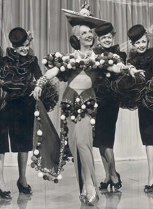 Carmen Miranda as Dorita in The Gang's All Here. In 1946, she was the highest-paid actress in the United States.[12]