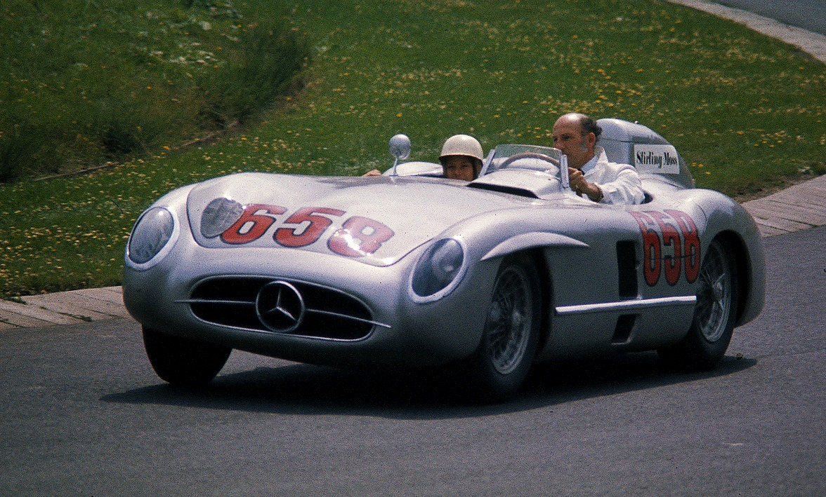 Stirling Moss drives former Mercedes racing teammate Juan Manuel Fangio's Mercedes-Benz 300 SLR at the Nürburgring in 1977