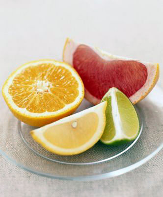 Wedges of pink grapefruit, lime, and lemon, an...