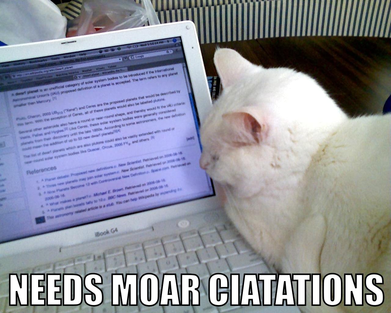 "cat lying on laptop, facing screen; text reads ""needs moar ciatations"""