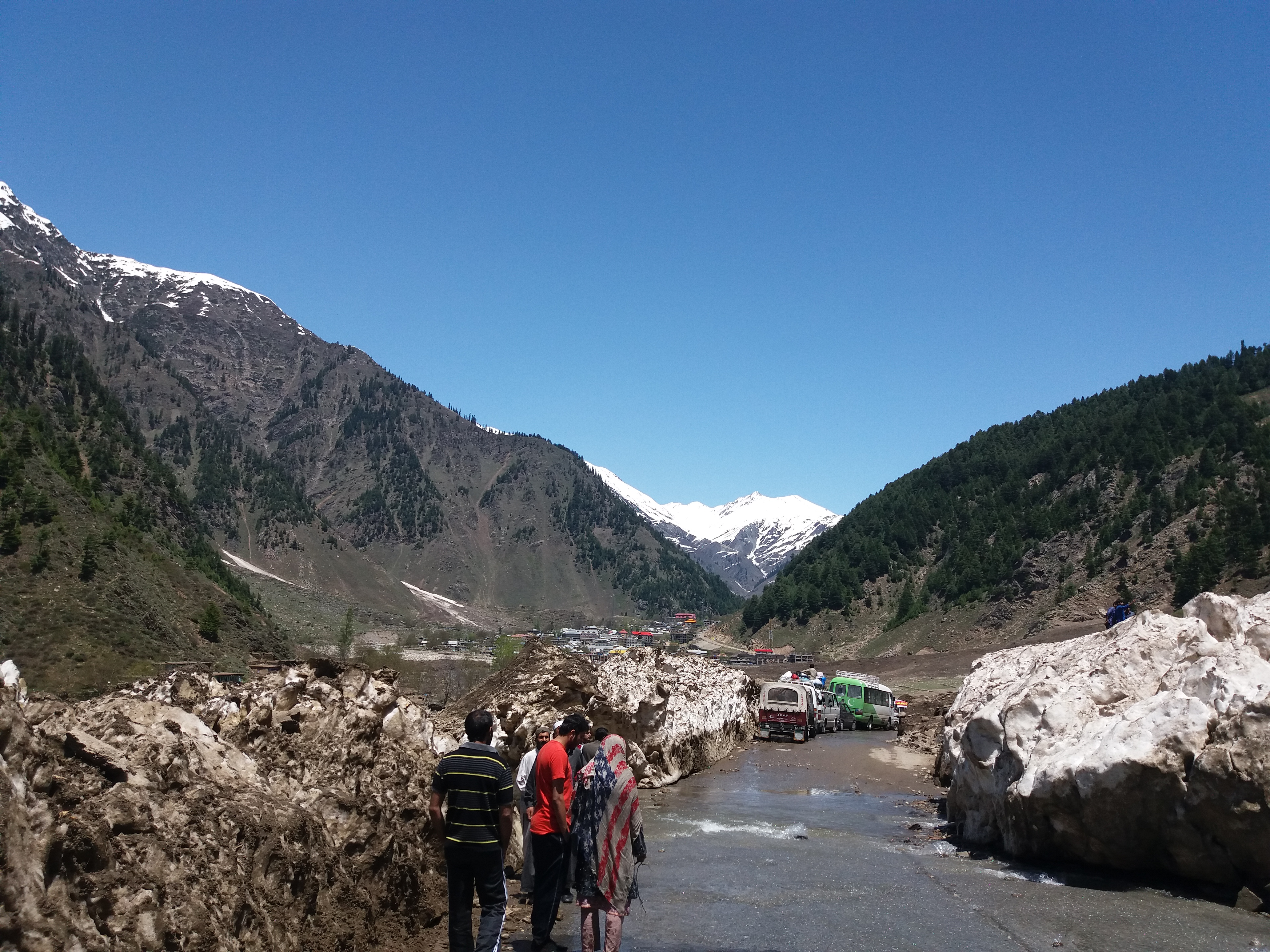 file road between the land slided snow mud glaciers jpg wikimedia