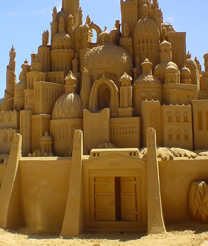English: Intricate sand castle sculpture, appr...