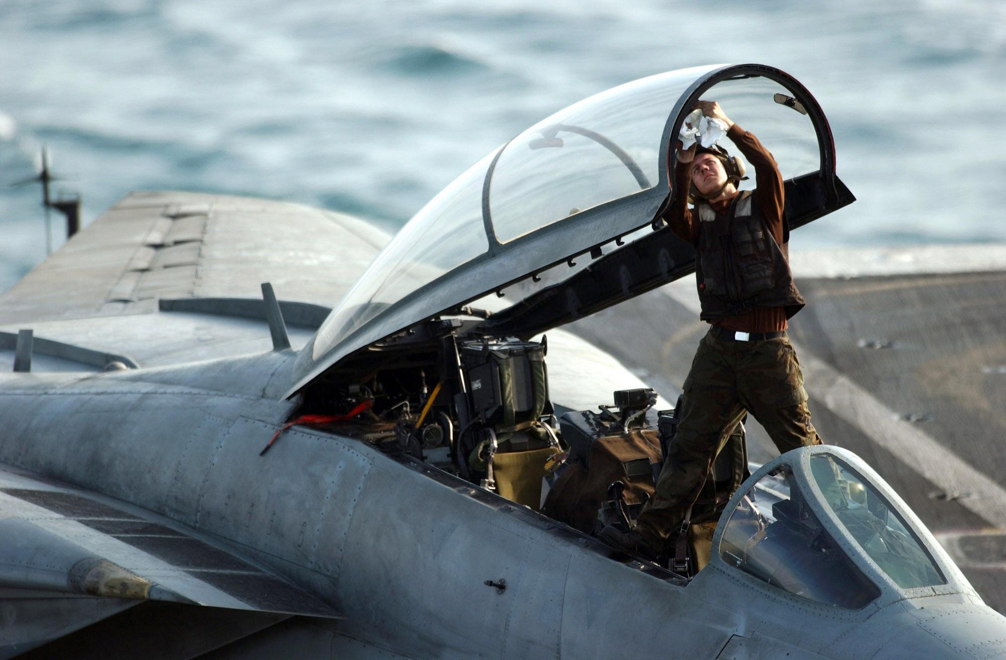 FileUS Navy 060202-N-7241L-001 A plane captain cleans the & File:US Navy 060202-N-7241L-001 A plane captain cleans the canopy ...
